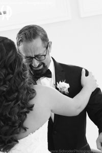 Bride's Dad see her in her dress for the first time.