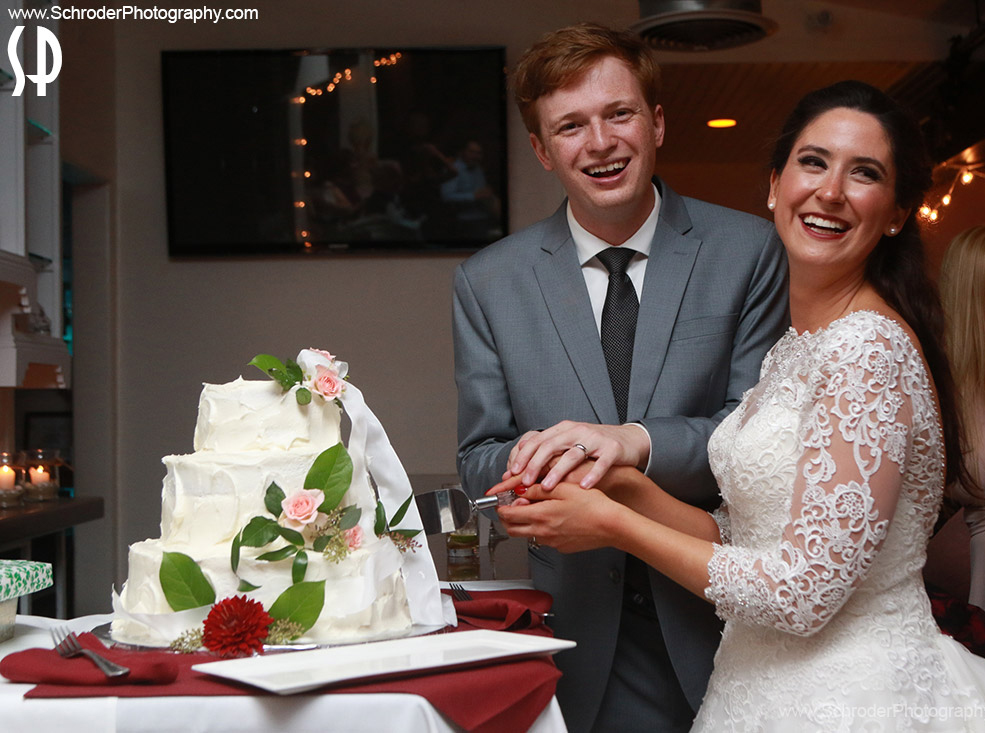 Bride and Groom cut their cake at avon by the sea