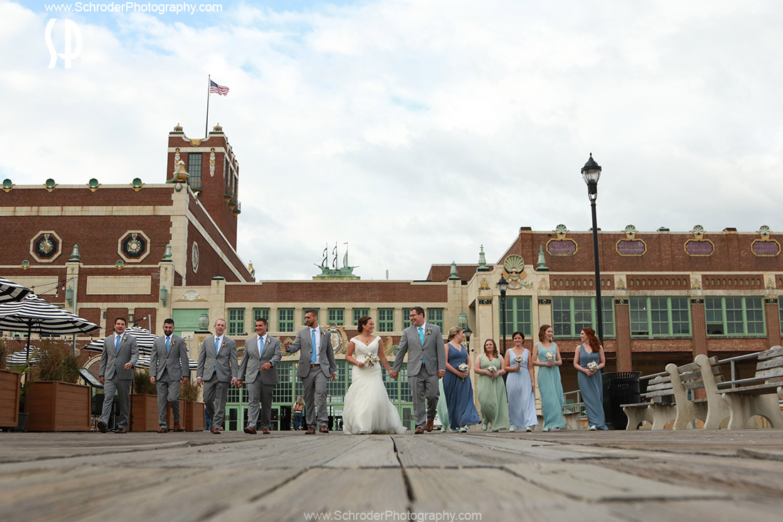 The entire wedding party on the boardwalk in Asbury Park