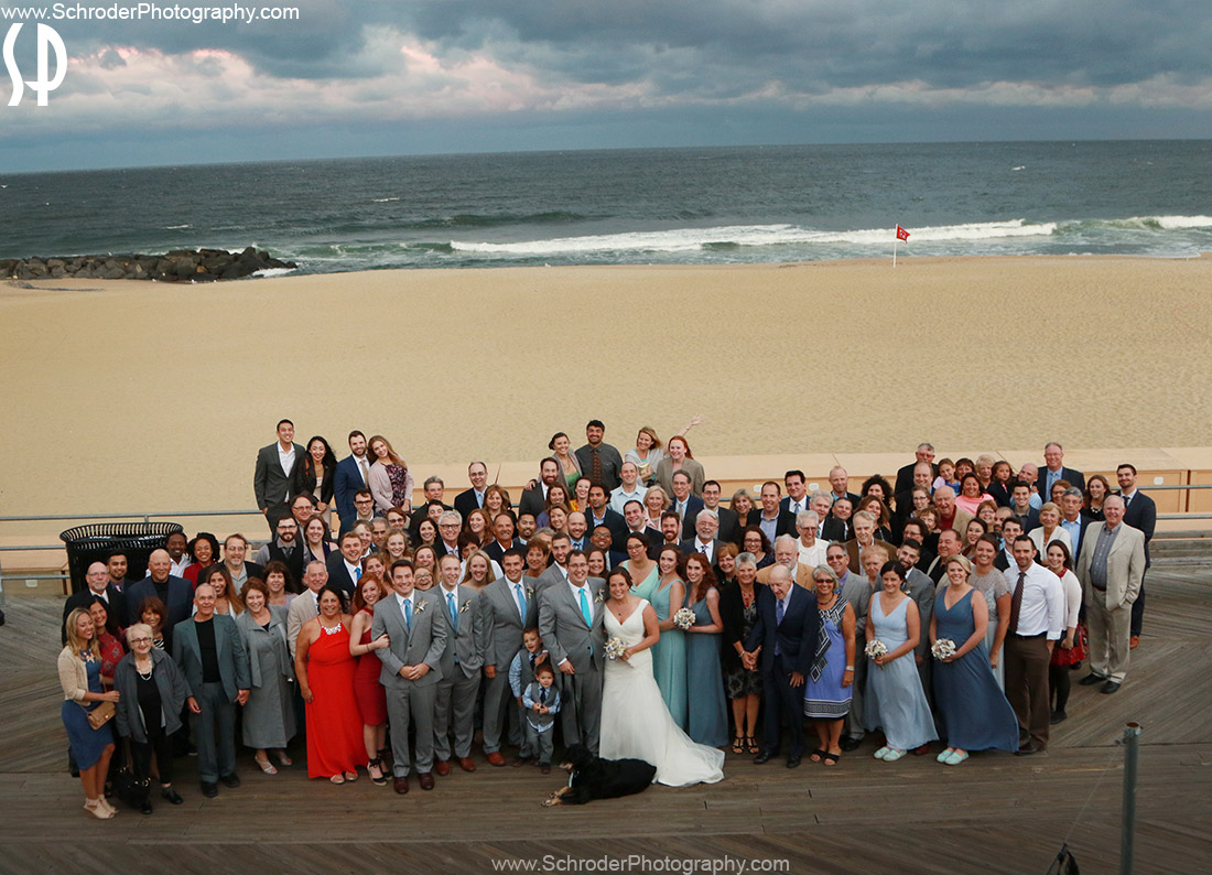 Everyone at the wedding posed for a group shot on the boardwalk in Asbury Park