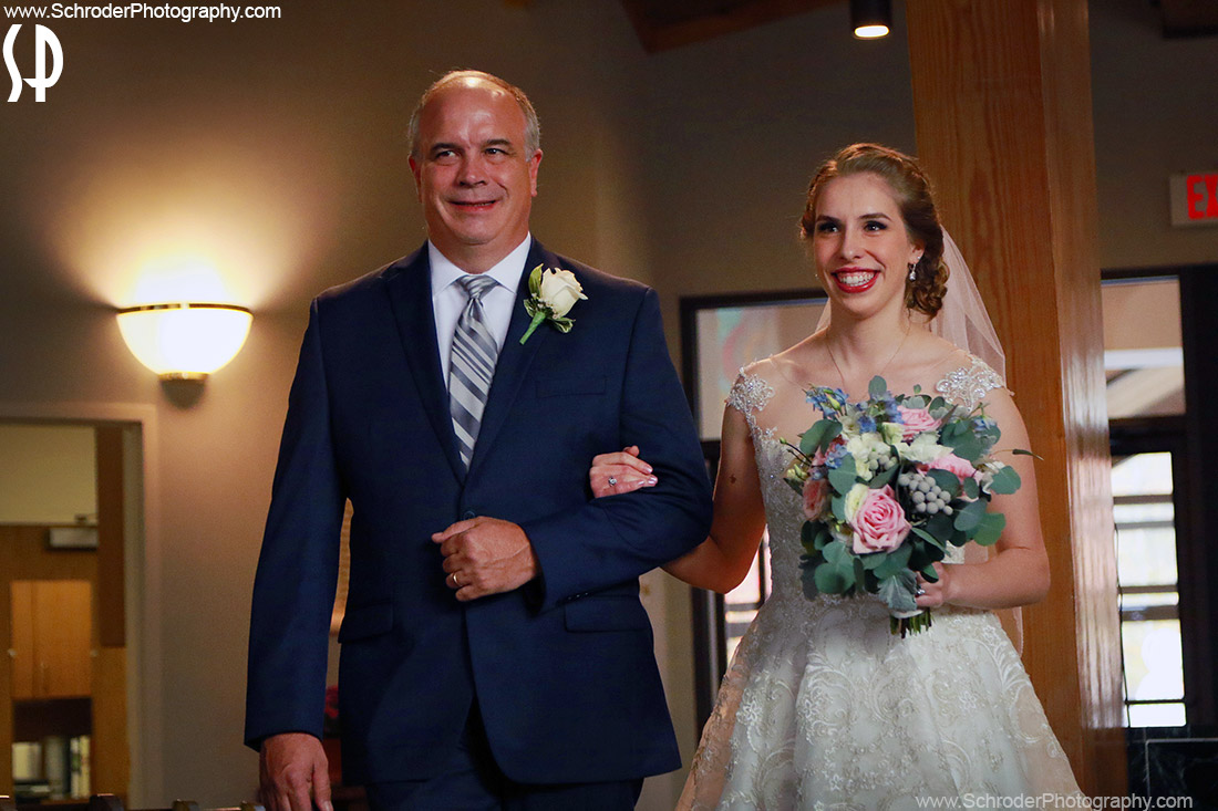 Samantha and her dad walk down the aisle at St. Anne's Church in Parsippany