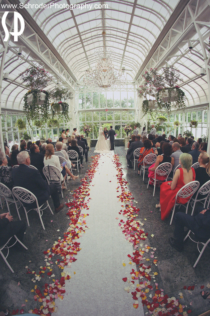 Ceremony at the beautiful Conservatory at the Madison Hotel in Morristown