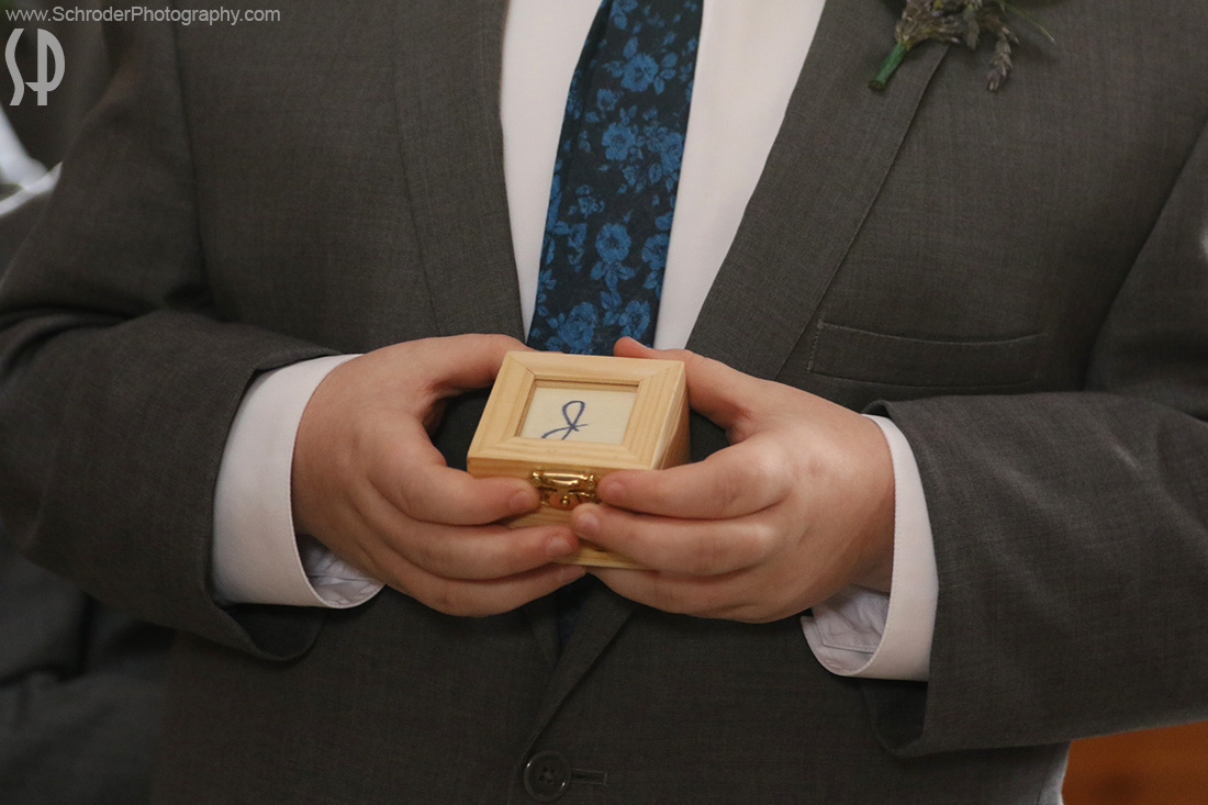 The Ring Bearer holds Jose's ring