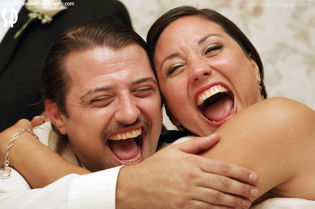 Newlyweds laugh during Toasts