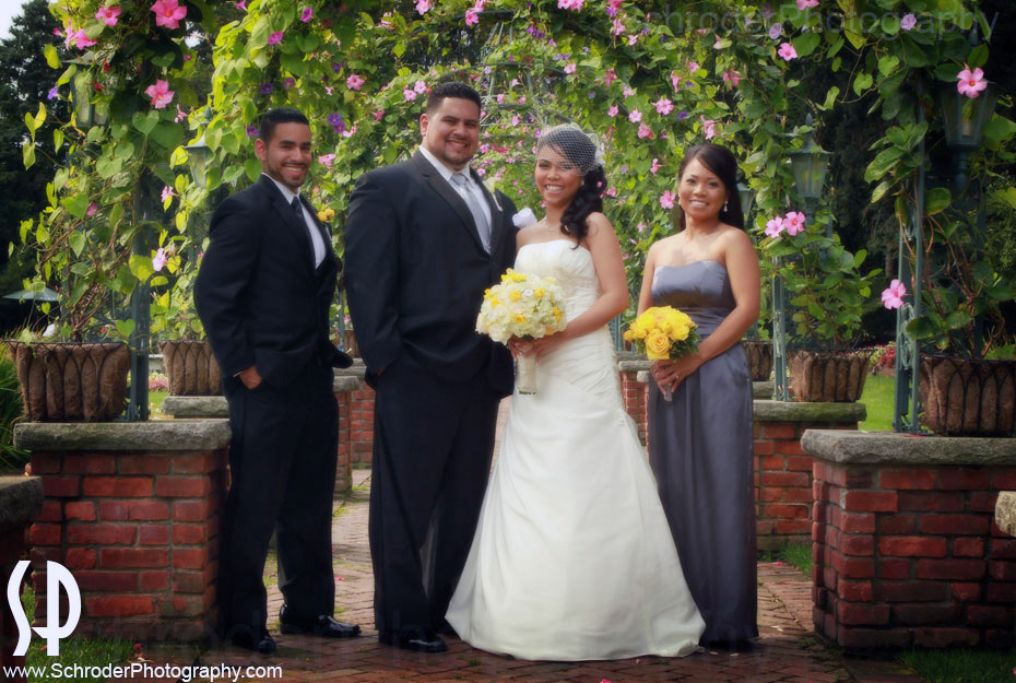 The Bride, Groom, Best Man and Maid of Honor pose for a photo.