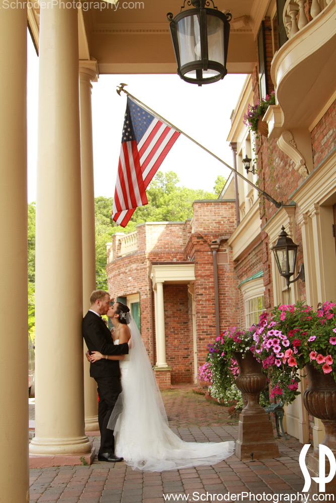 Bride and Groom at the front entrance of The Manor