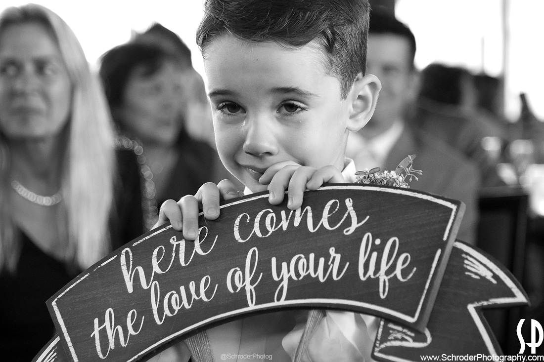 Ring Bearer fights tears but accomplished his mission!