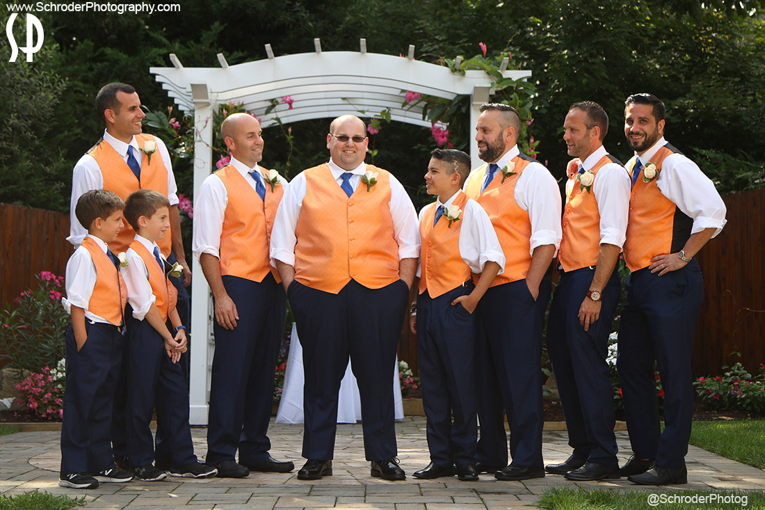 Alex is a Yankee Fan but he and his best man wore Met Blue and Orange
