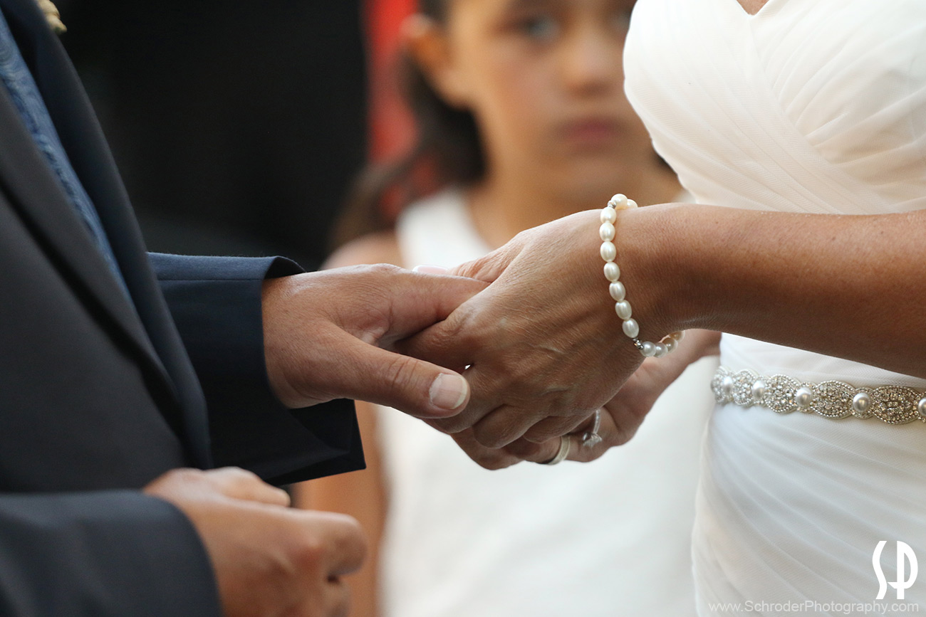 Close up of Bride and Groom holding hands during the ceremony